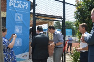 PHTC President Peter Mattessi helps Sports Minister John Eren punch in his gate code.